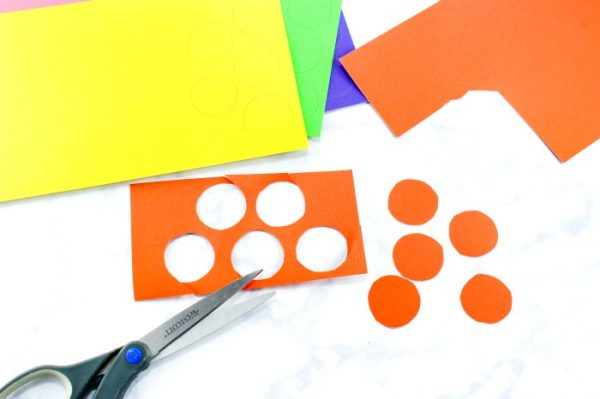 Cut circles out of different coloured paper and fold them in half.